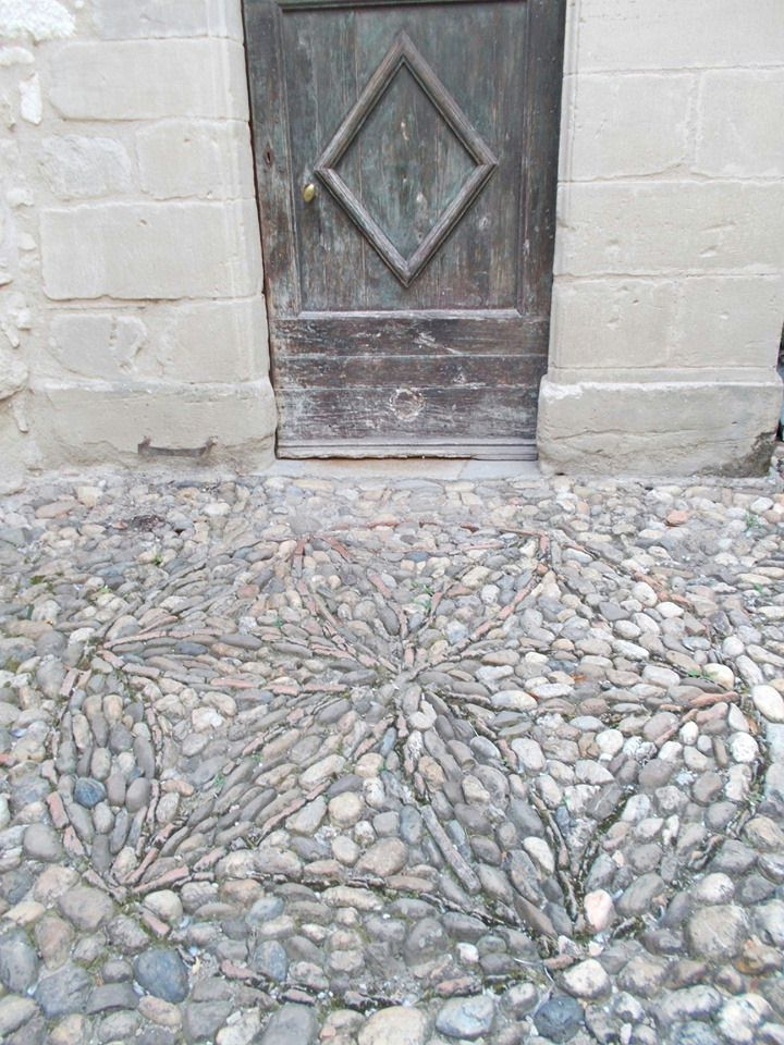 Vast Apotropaic Mark in the cobbles at Chateau de Brametourte